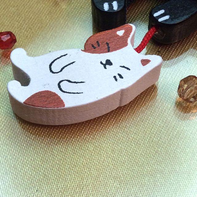 のあぷらす社もりまさこ先生の木製親子ストラップ黒猫のこねこ部分アップ写真