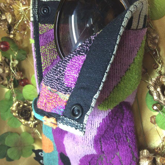 マタノアツコロングポシェチーフ紫にサングラスを入れた画像
