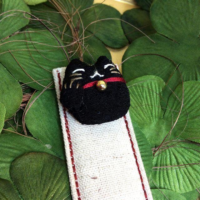 ドン・ヒラノさんのおしゃれな布しおり招き猫黒色の猫部分のクローズアップ画像