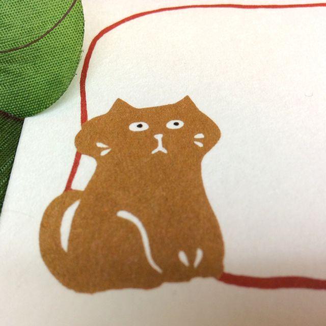 はねうたゆみこさんの猫まめふみ箋セットの便せんの茶色の猫のクローズアップ画像