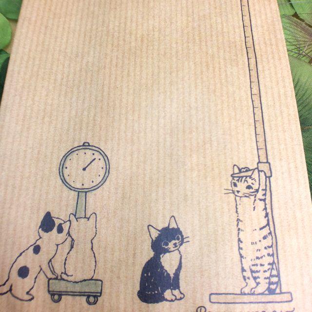 ポタリングキャットさんの猫の茶封筒12枚入りのはかりの部分のクローズアップ画像