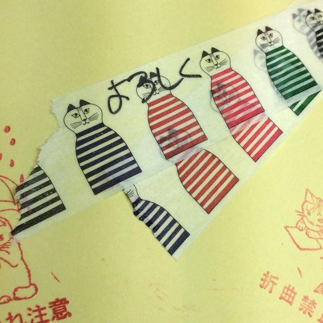 カモ井のリサ・ラーソン猫柄マスキングテープを封筒に貼って、テープの上に文字を書いて、重ねバリした画像