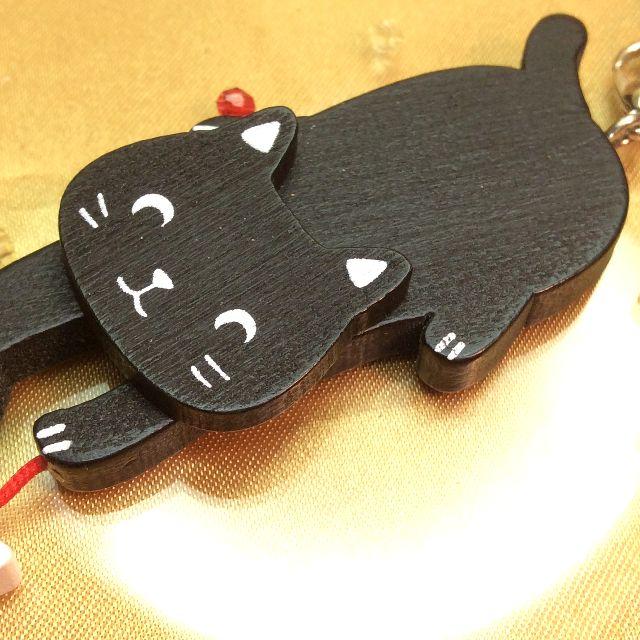 のあぷらす社もりまさこ先生の木製親子ストラップ黒猫の親猫部分アップ写真