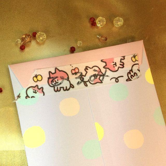 カナヘイさんのきょーふ!ゾンビ猫のマスキングテープを封筒の裏に貼って、文字をテープの上から書いたところのアップ写真
