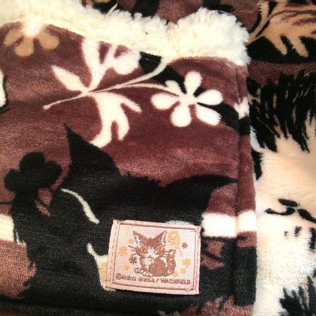 ダヤンの腰巻ブランケットのポケットのダヤンの織りネーム部分のクローズアップ画像