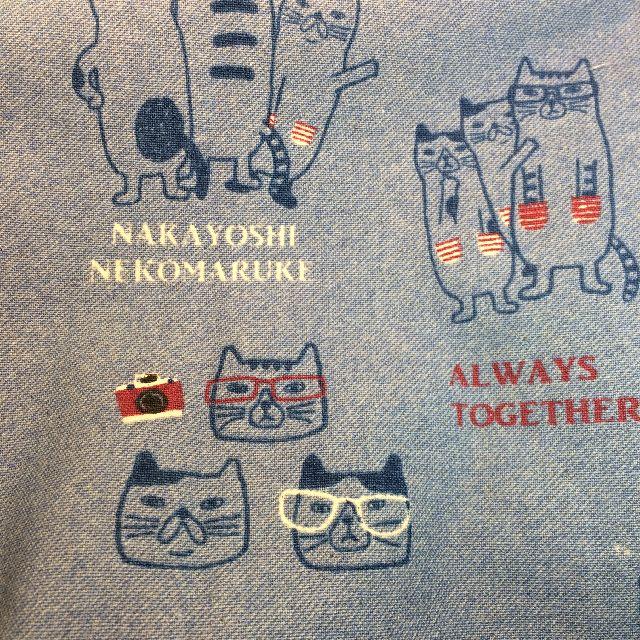 クスグルジャパンの割烹着の猫柄のクローズアップ画像