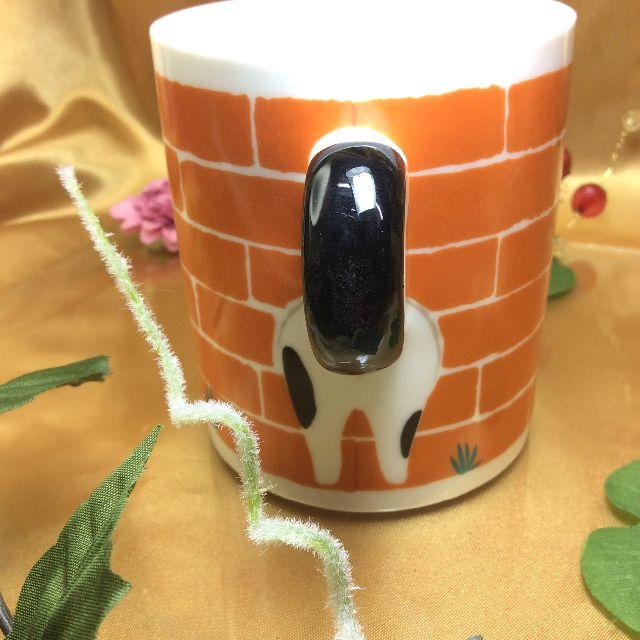 デコレ塀からこんにちはマグカップの持ち手部分の画像