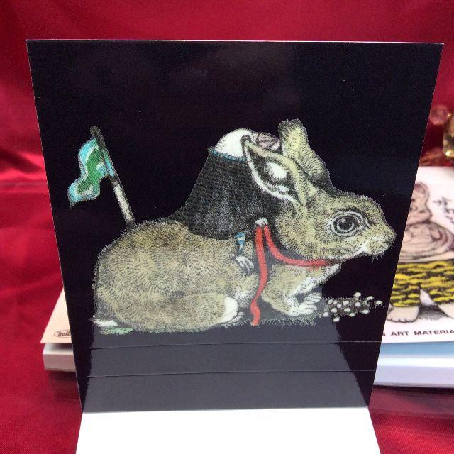 ヒグチユウコさんの猫と蟻の柄のメモ帳の表紙の裏側の画像