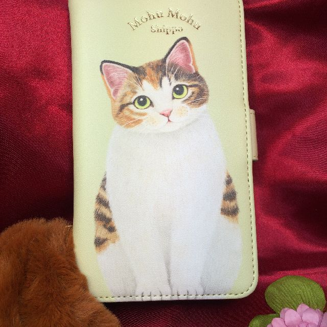 フェリシモ猫部のブック型スマホケース、尻尾付き茶トラ柄の全体画像